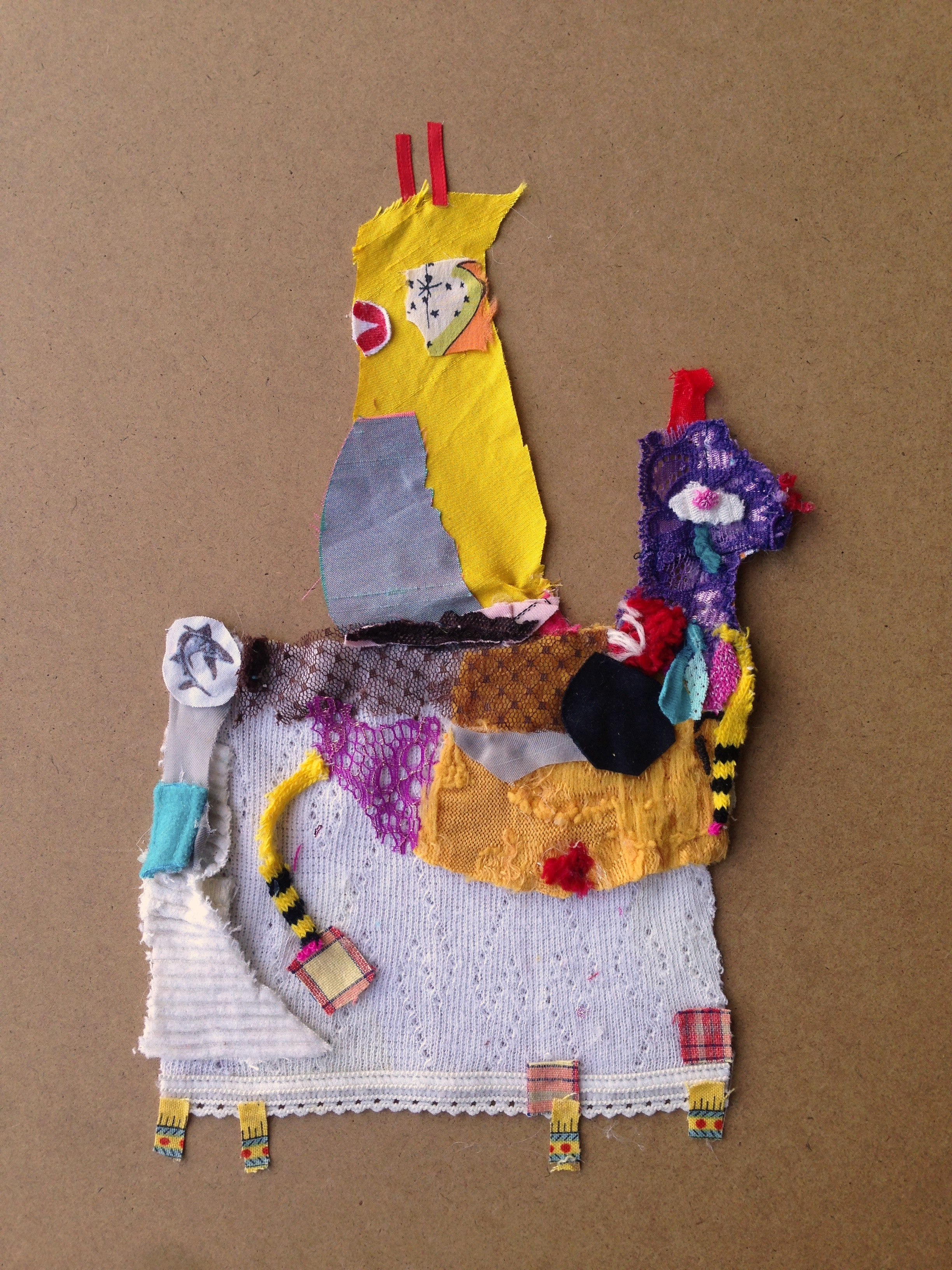 No Name Horse with Two Frozen Heads Stuck in a Stare  20.5 x 20.5 inches  Recycled fabric: Corduroy, velvet, satin, silk, shark pajamas, lace, old socks and ribbons.  2015