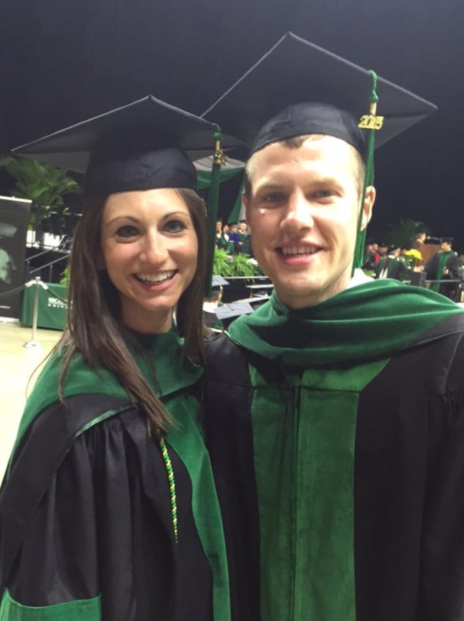 Sarah Hartwick - obgyn resident - with her husband at their medical school graduation