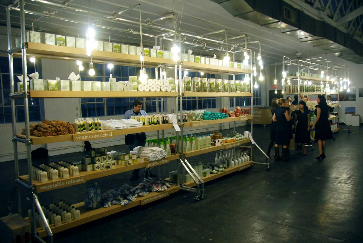 THE GREENMARKET MAIN SPACE, SHELVING MADE OF RECYCLED STEEL TUBES, LOW WATTAGE BULBS, RECYCLED MDF