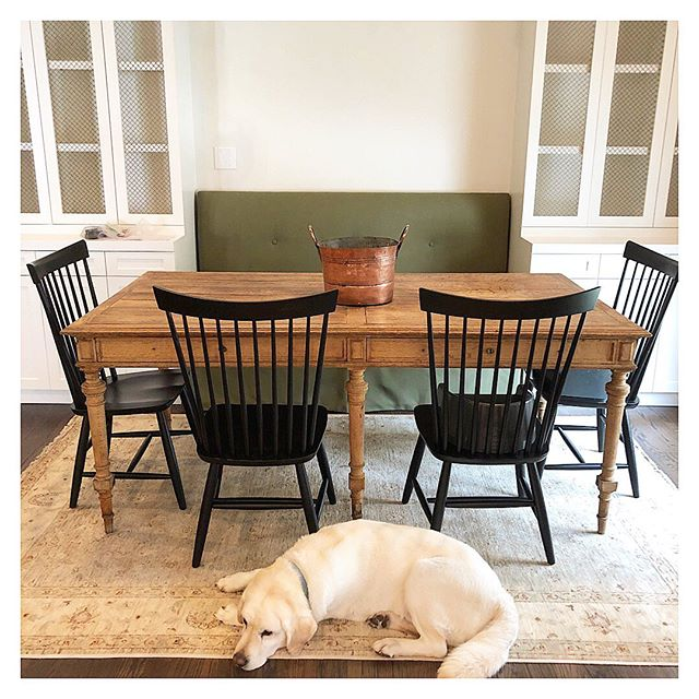 Progress shot of this custom breakfast nook 💚... (made even cuter by 🐶) #jbinteriors #custom #builtins #artready #banquet #green #bench #antique #new #copper #designhouston #houstondesign #breakfastroomdesign
