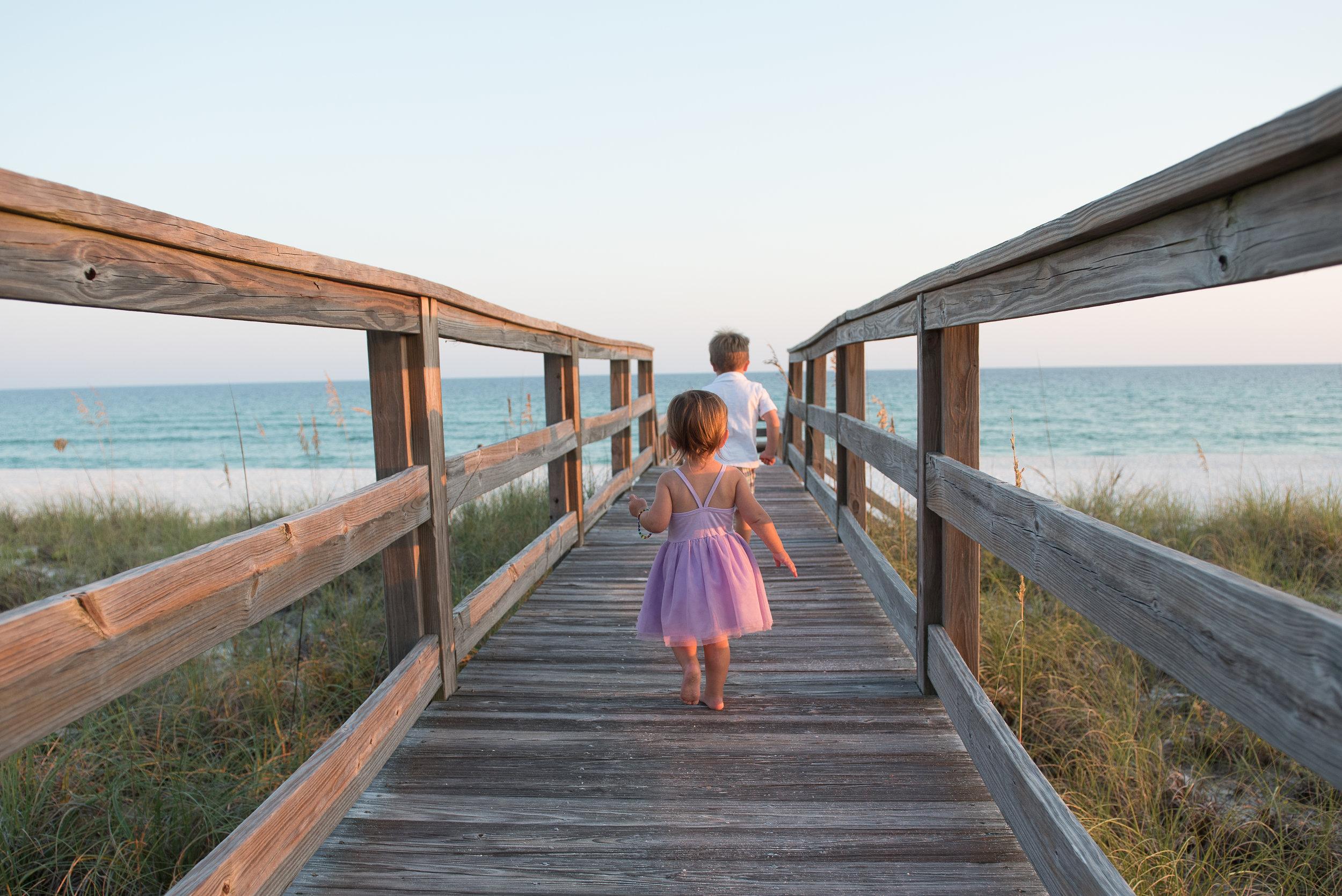 kids on boardwalk running- Navarre Beach Child Photographer