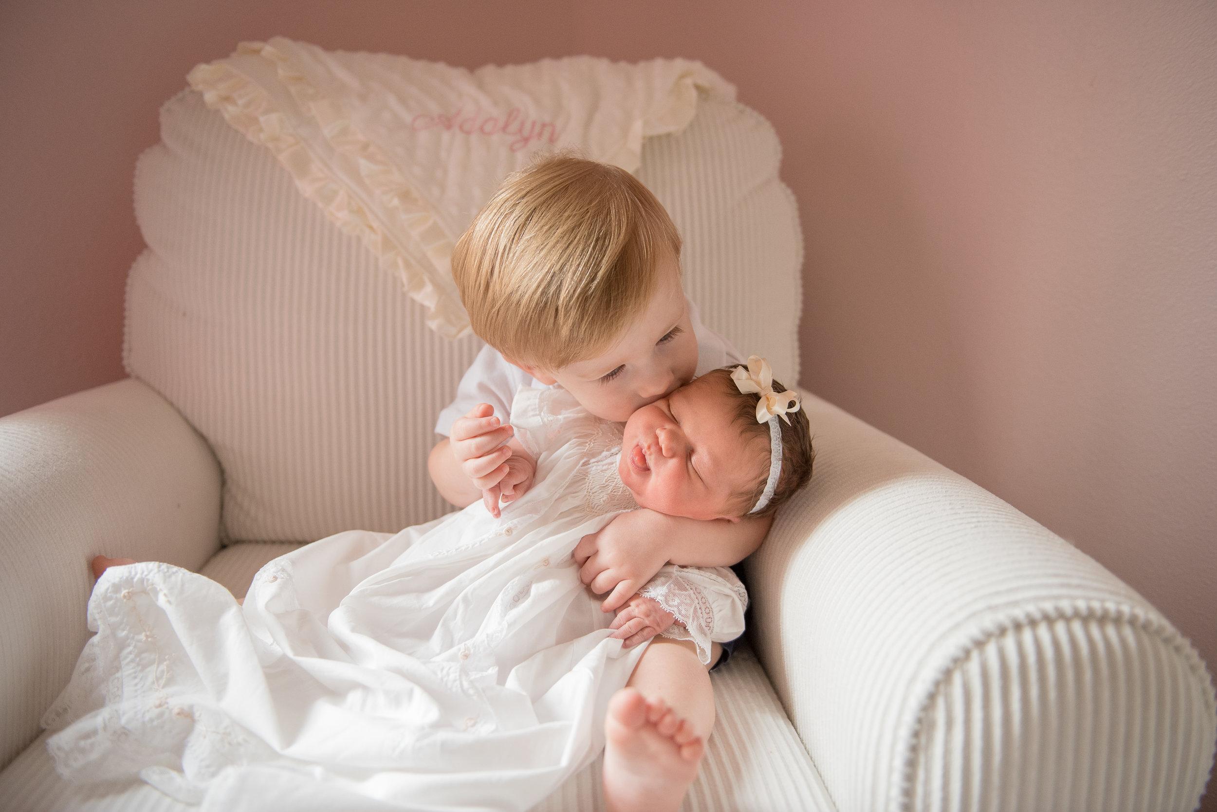 brother kissing sister- Pensacola Newborn Photographer