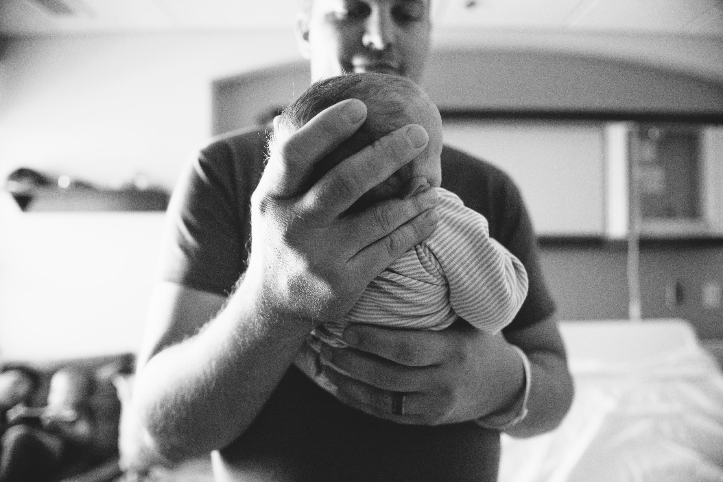 newborn in dads hands