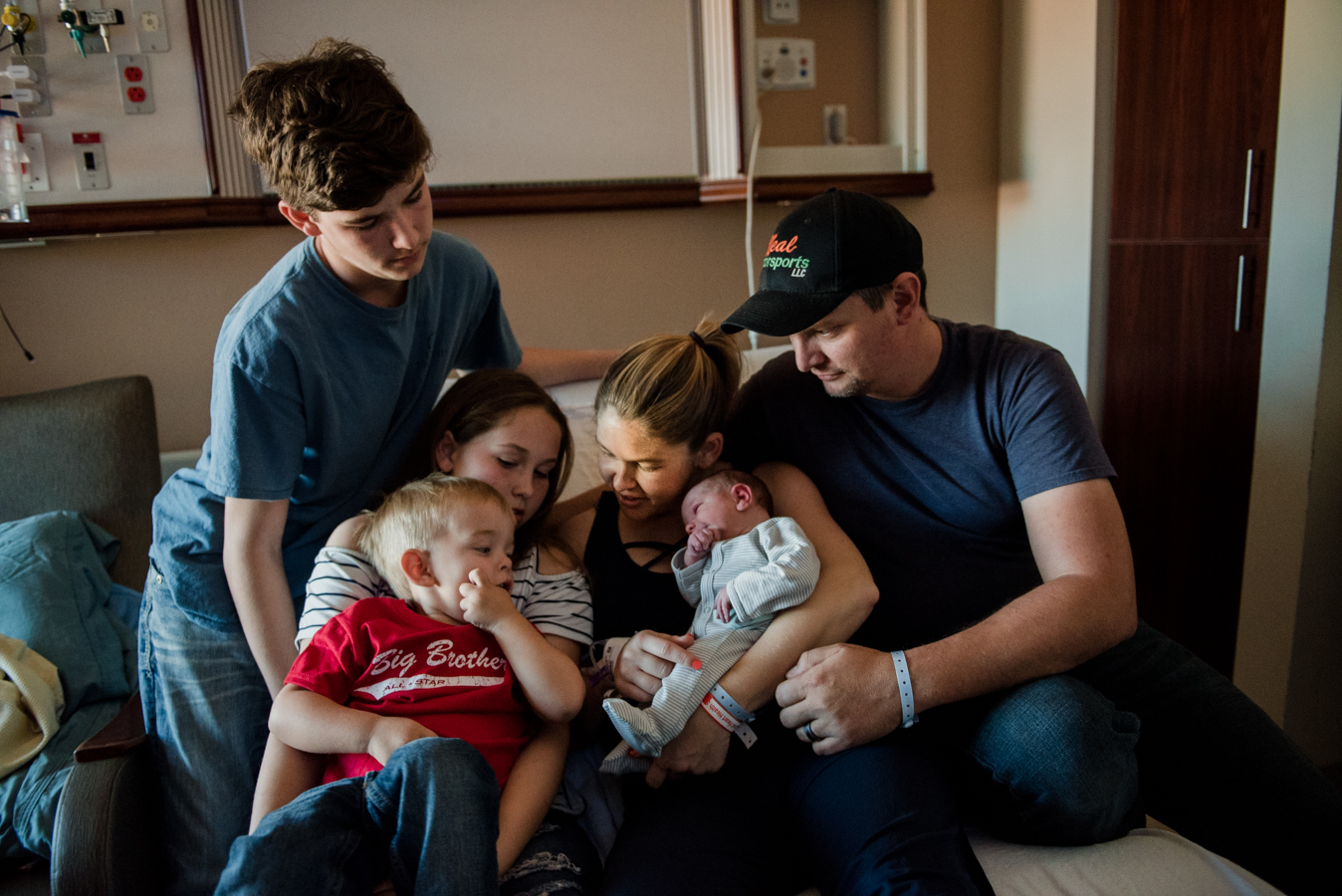 family gathered around baby- pensacola family photographer
