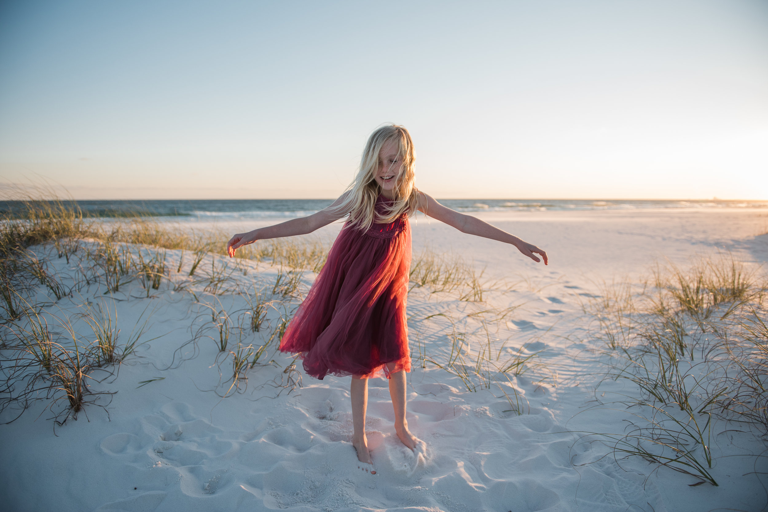 girl twirling in red dress-child photographer-Pensacola