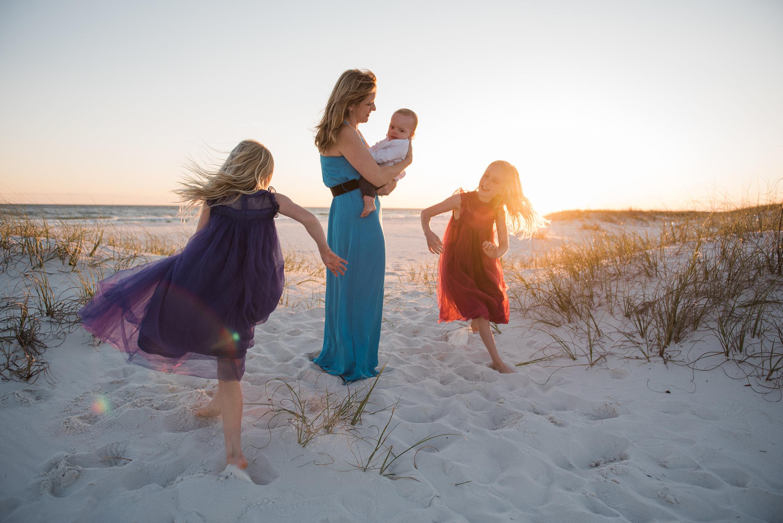 girls running around mom-pensacola beach family photographer