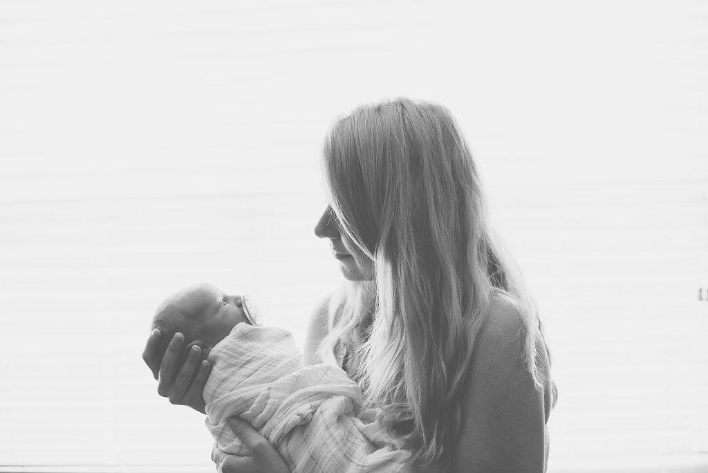 mom holding baby-Gulf Breeze newborn photographer