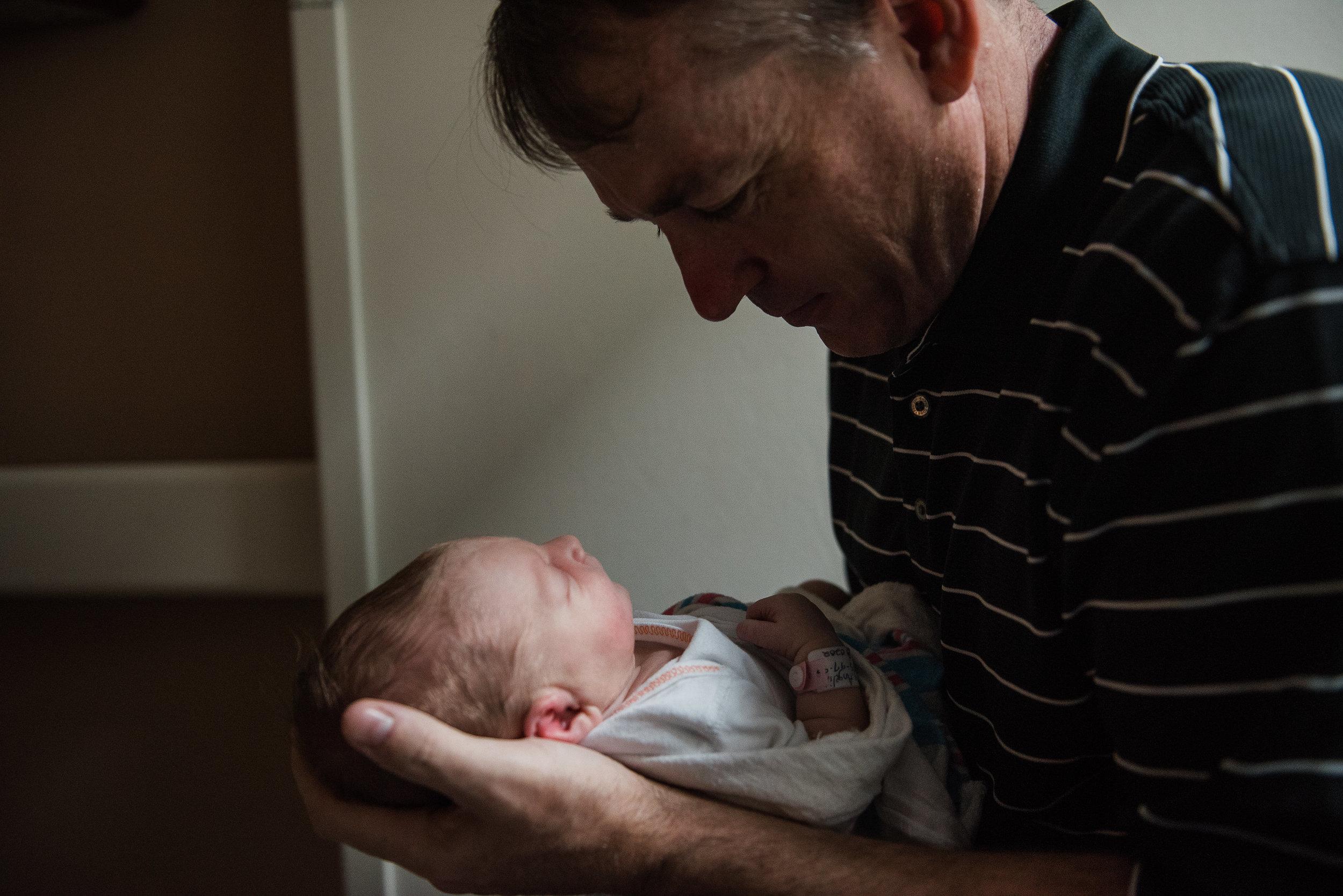 dad cradling baby-fresh 48 photographer