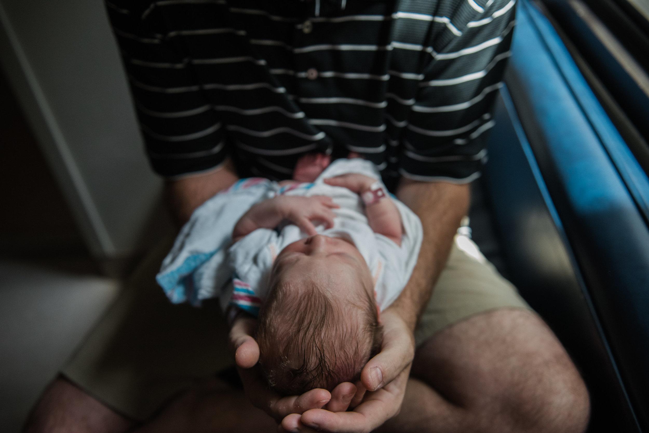 baby facing out-newborn pensacola photographer