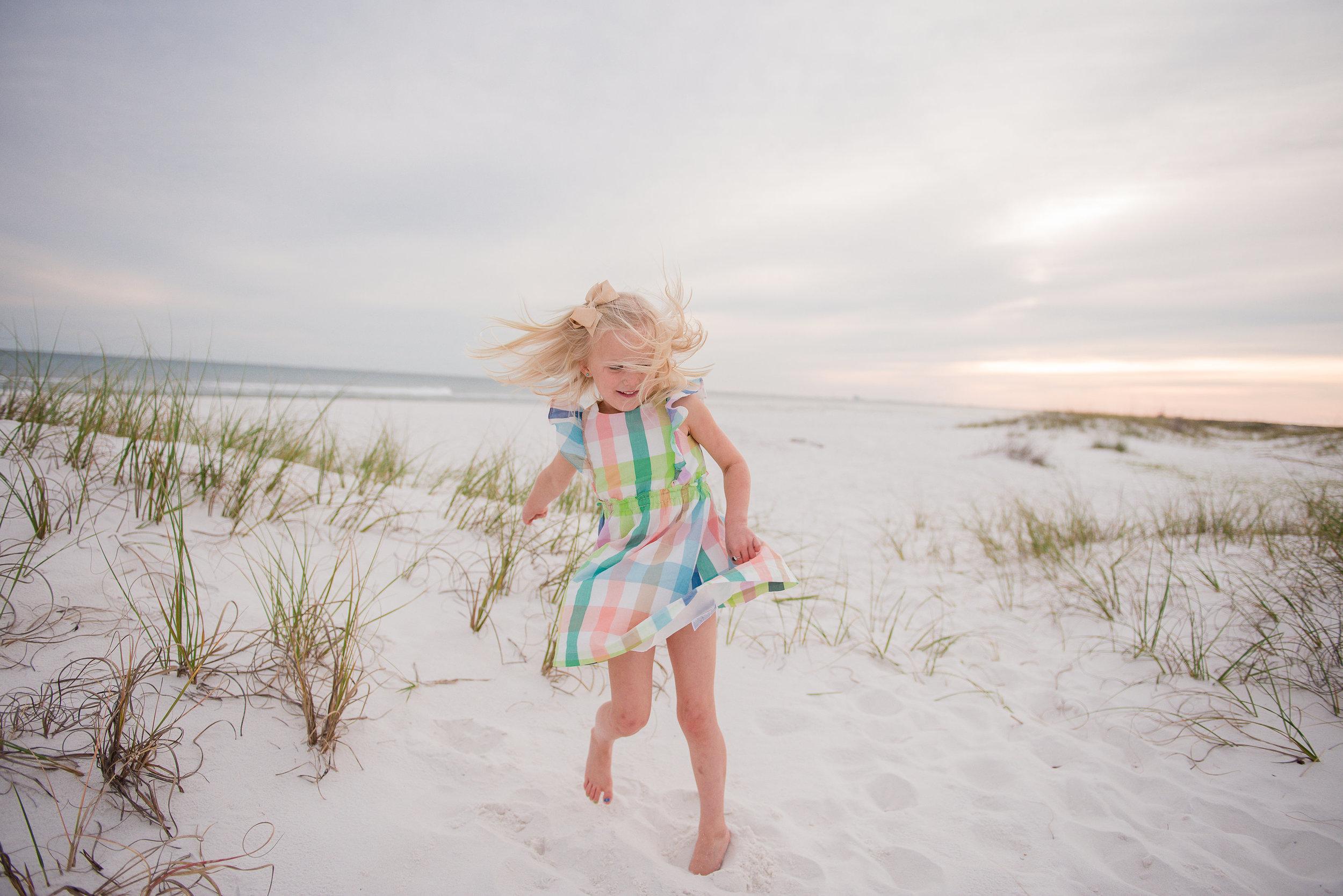 kid twirls-pensacola beach photographer