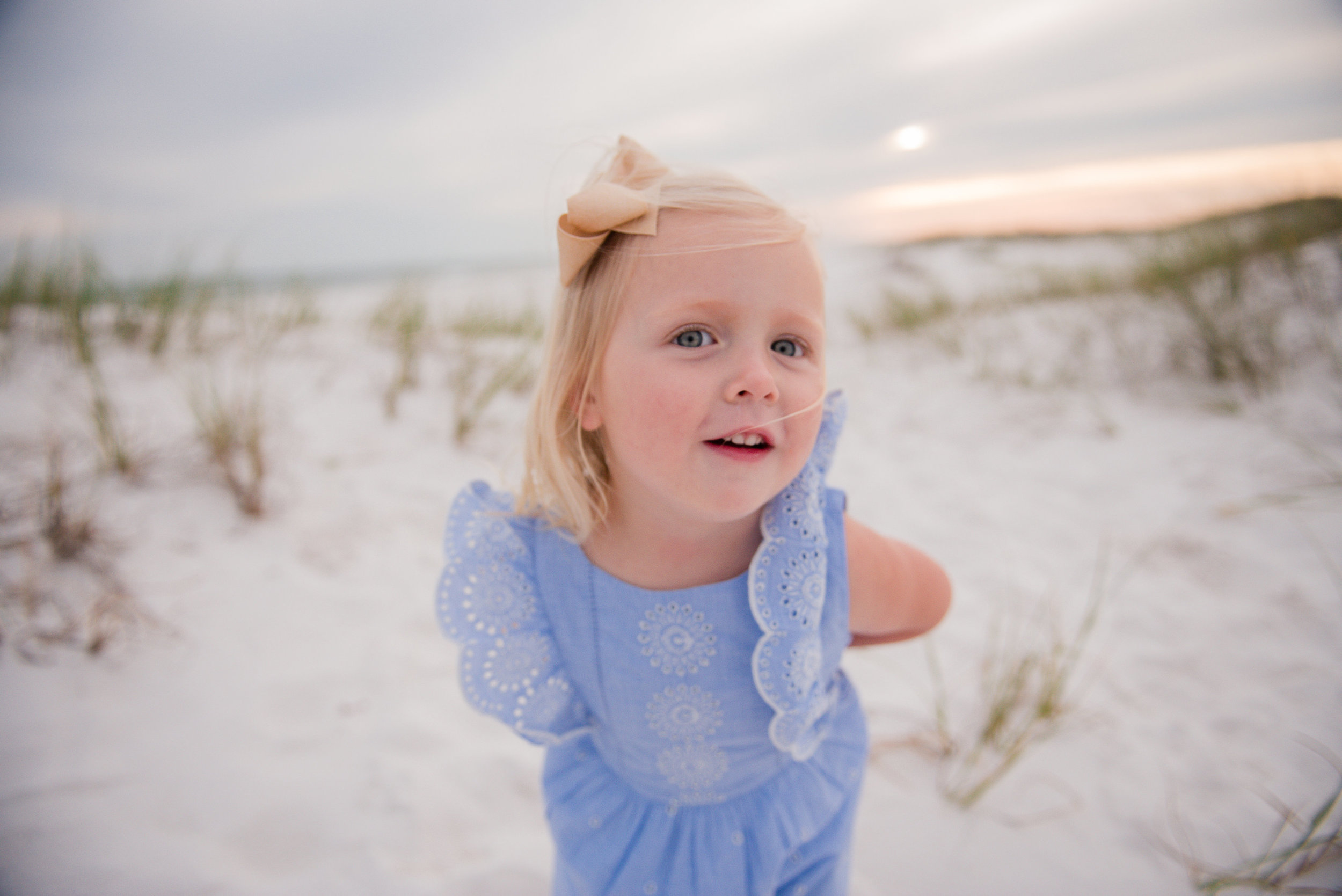 girl in dune-pensacola beach family photographer