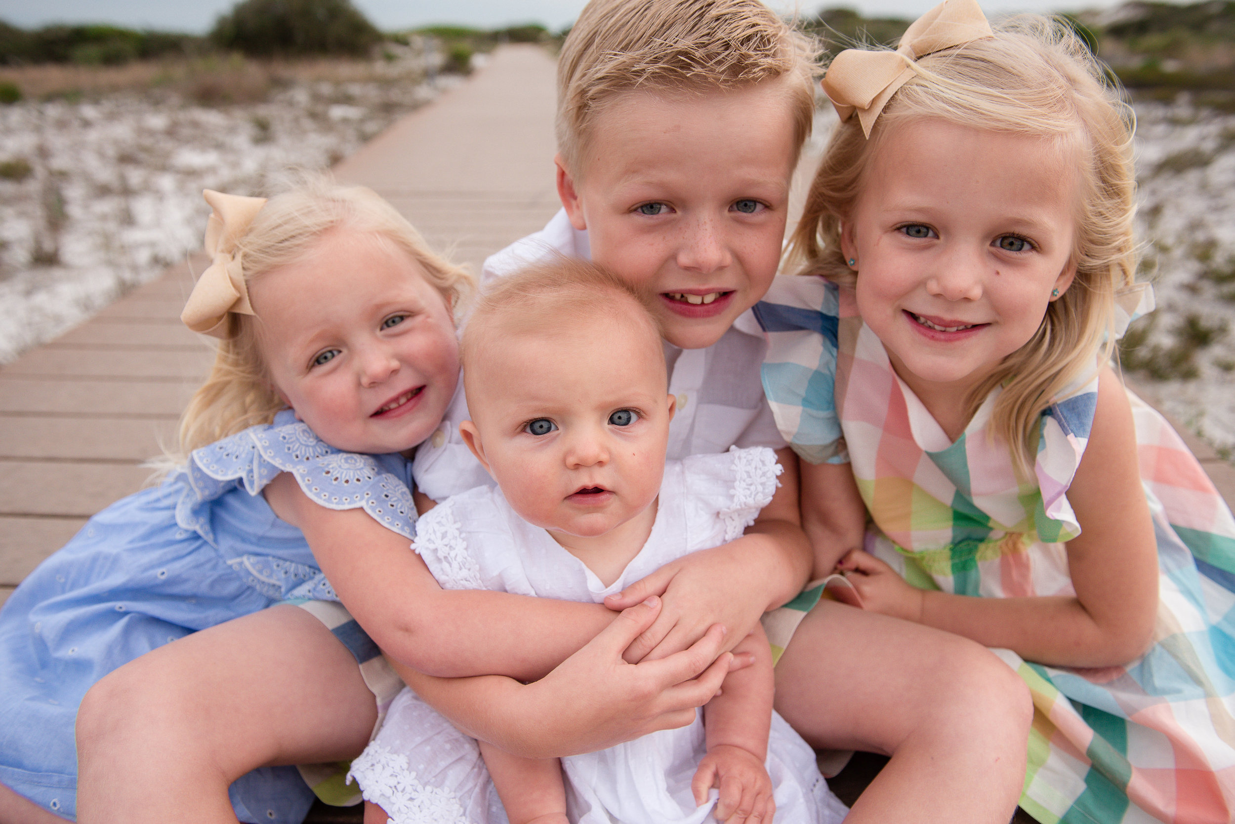 kids hugging on boardwalk-Pensacola Beach Family  photographer