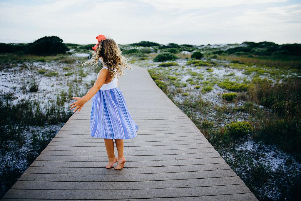 girl on tip toes-Pensacola Beach Photographer