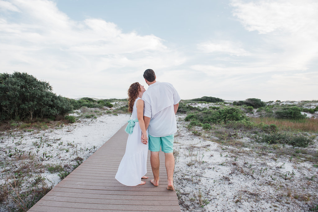 man and woman walking-Pensacola Beach photographer