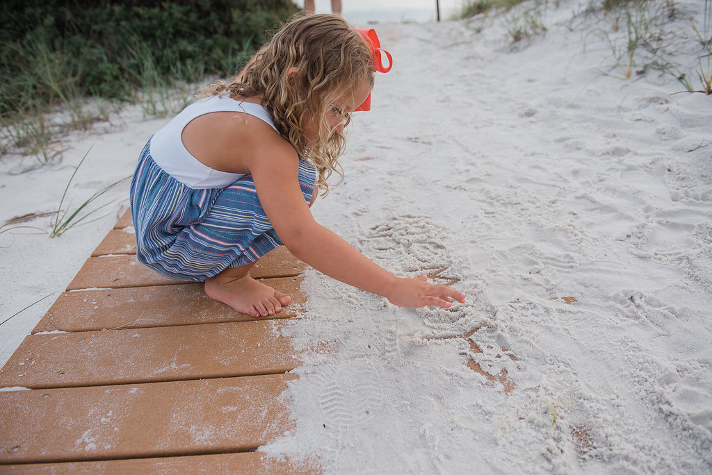 girl in sand-pensacola beach photographer