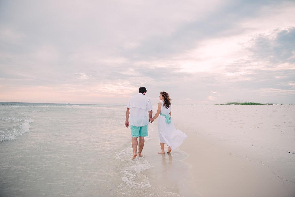 walking in sand couple-pensacola photographer