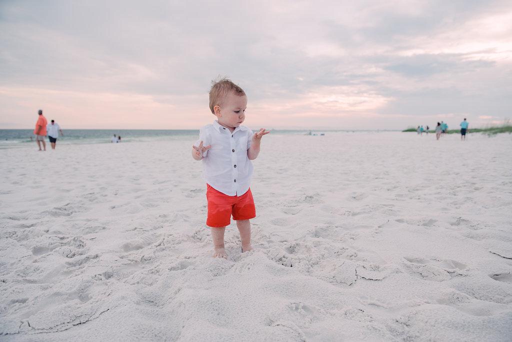 toddler in sand-pensacola photographer