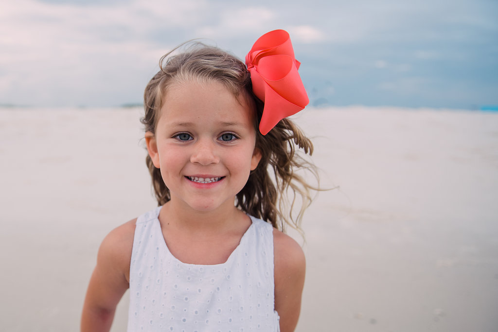 girl with bow at beach-pensacola photographer