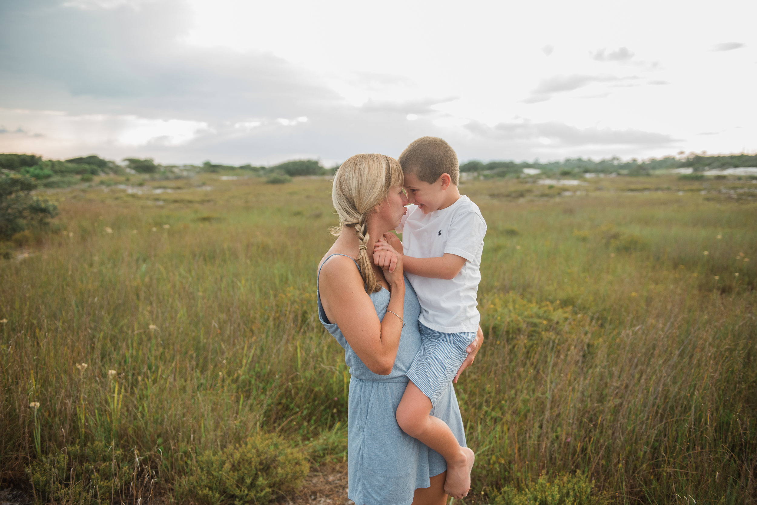 mom with son in sea grass- Pensacola Family Photographer