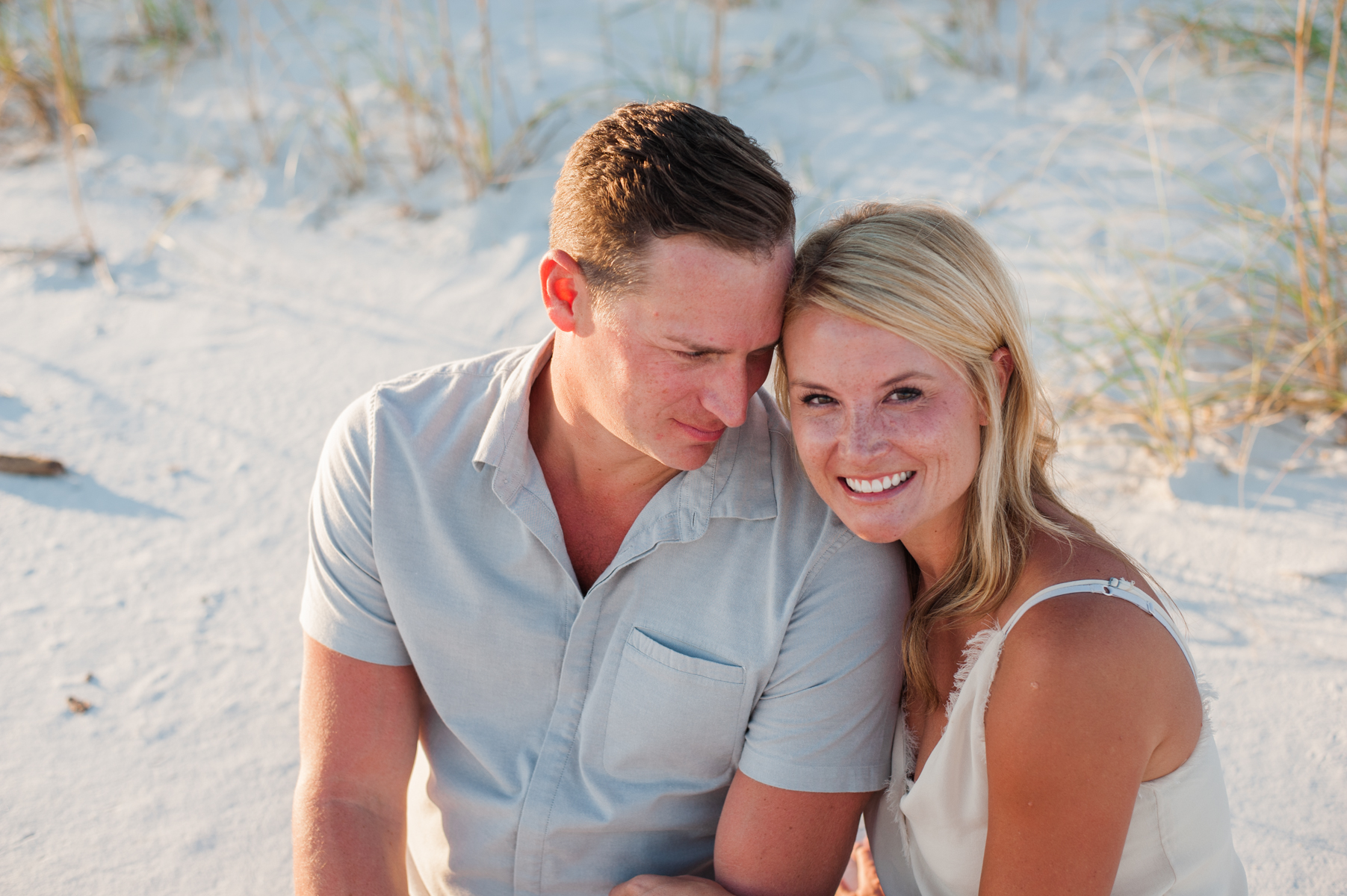 man gazing at wife- Pensacola Family Photographer