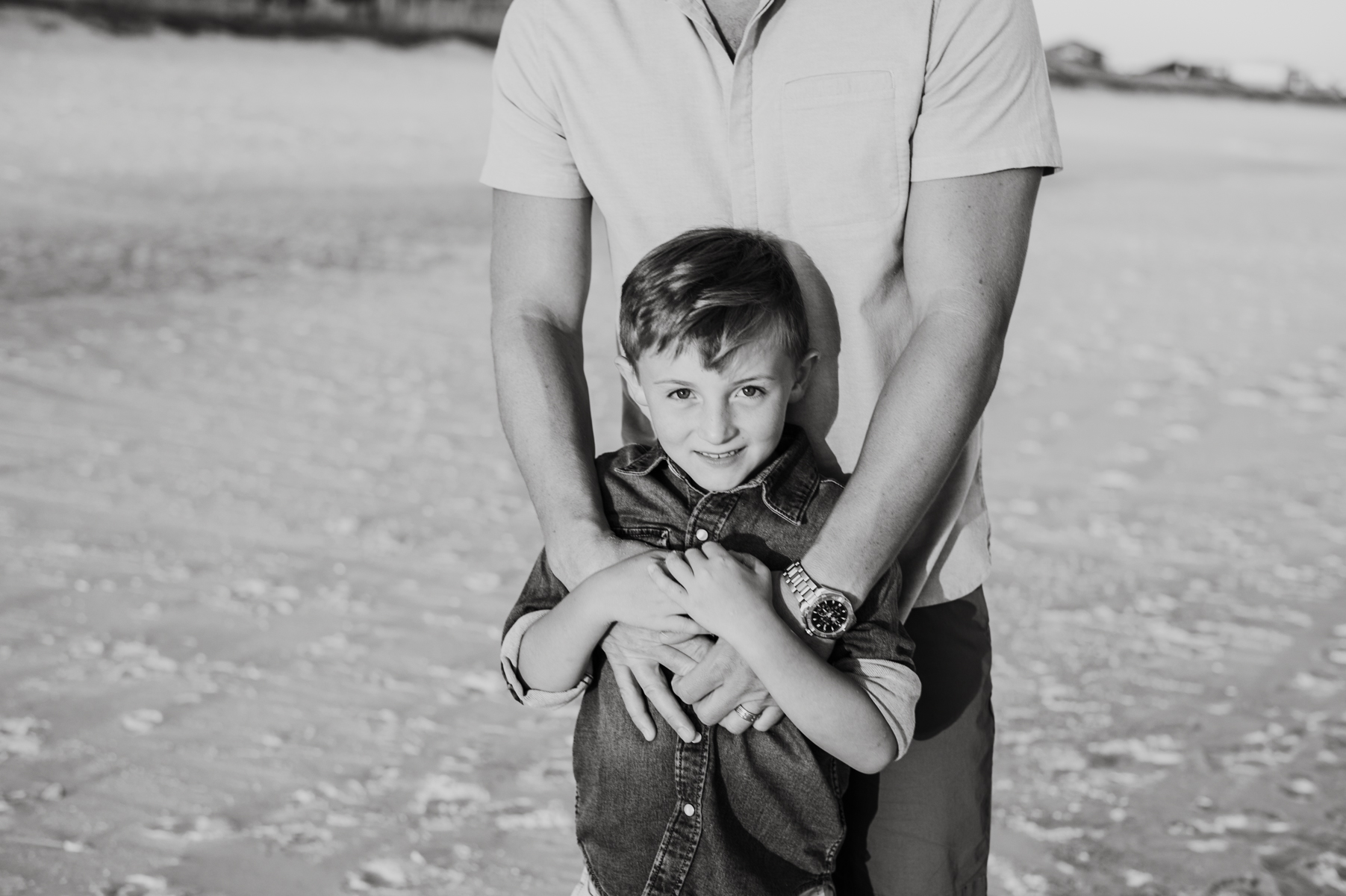 boy being held by dad-pensacola family photographer