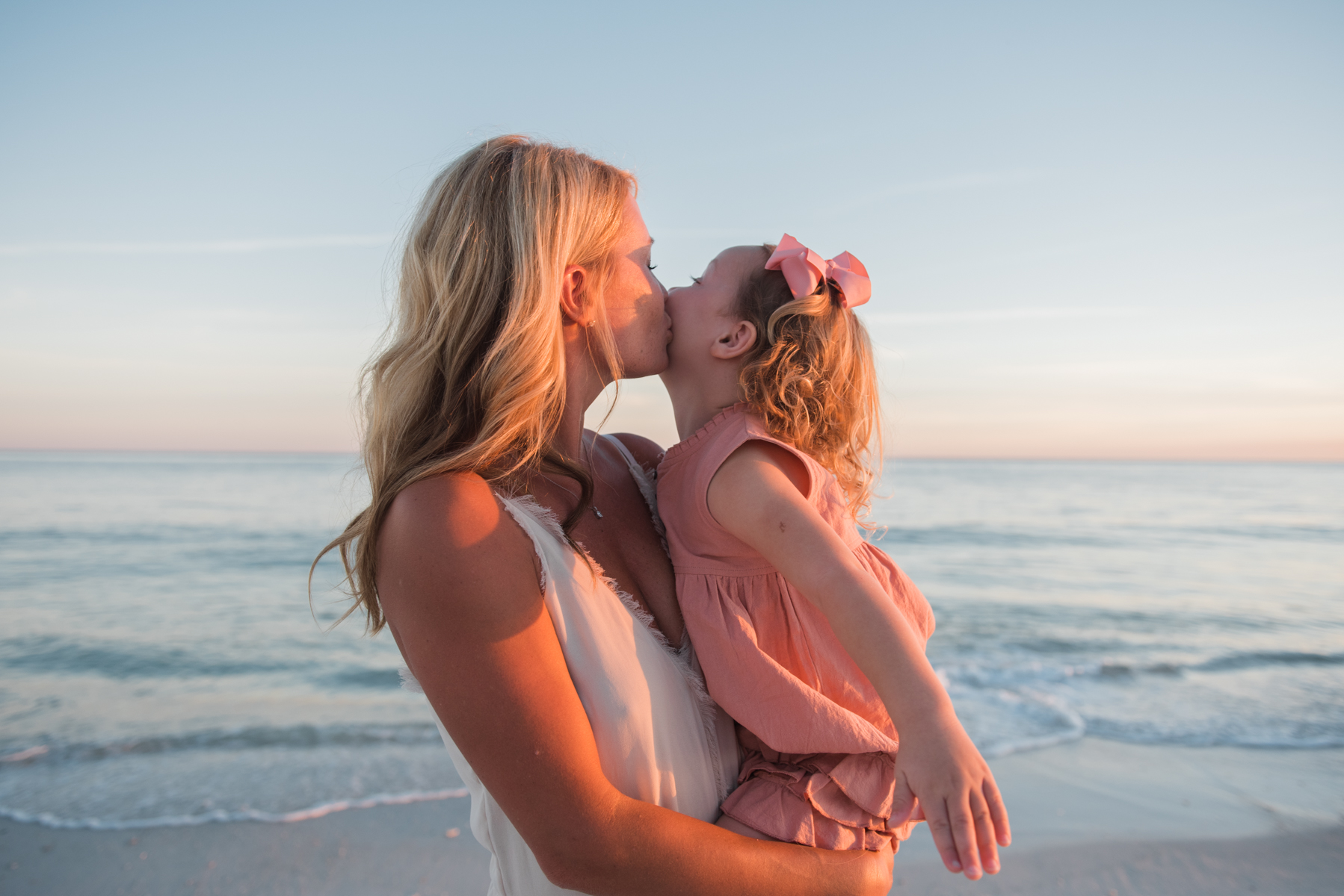 daughter kissing mom at beach-pensacola family photographer