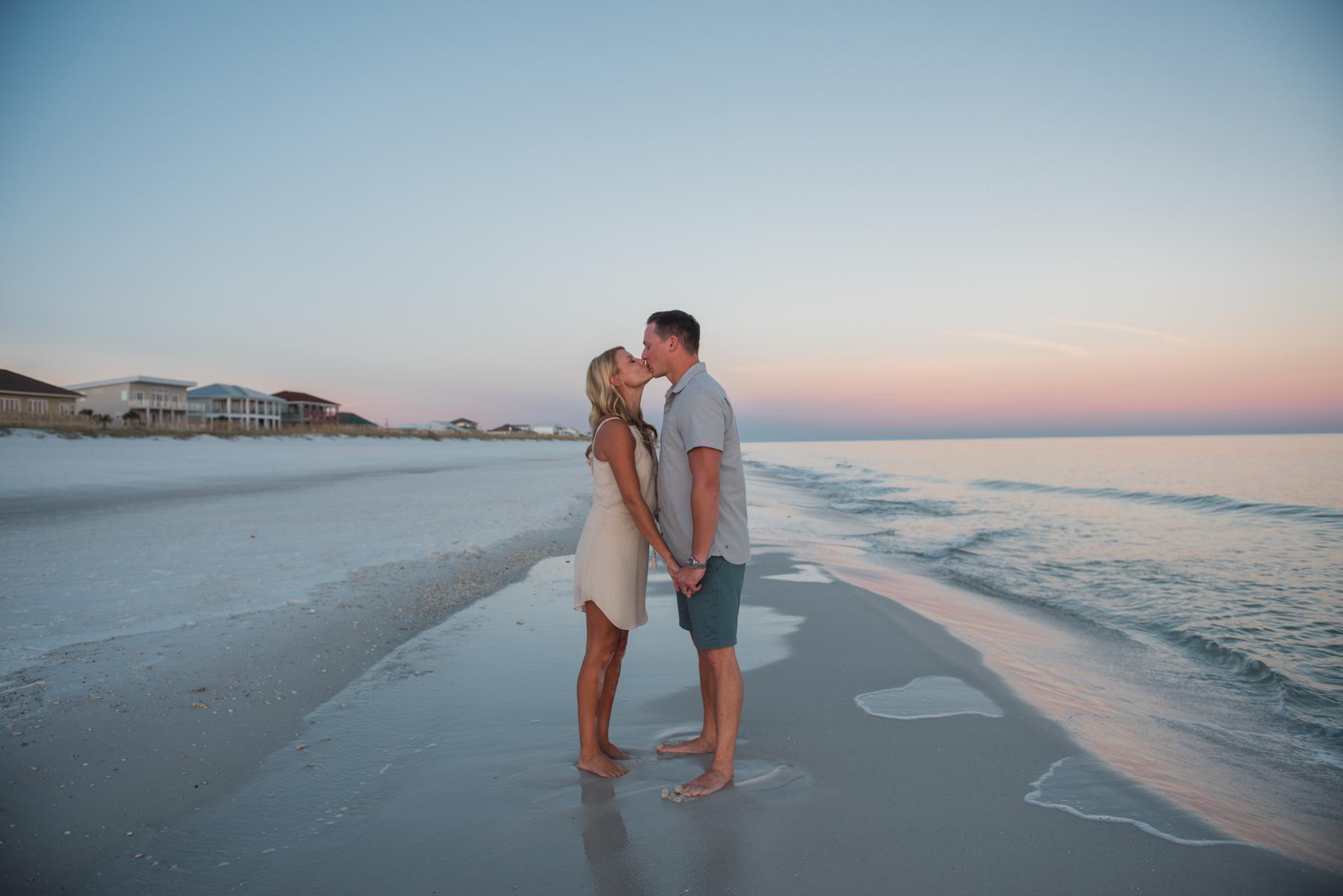 couple kissing at beach- pensacola family photographer