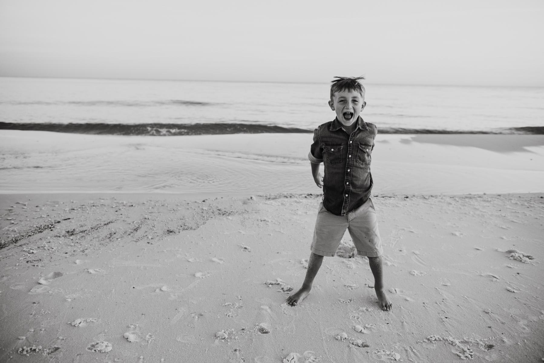 boy at beach-pensacola beach family photographer