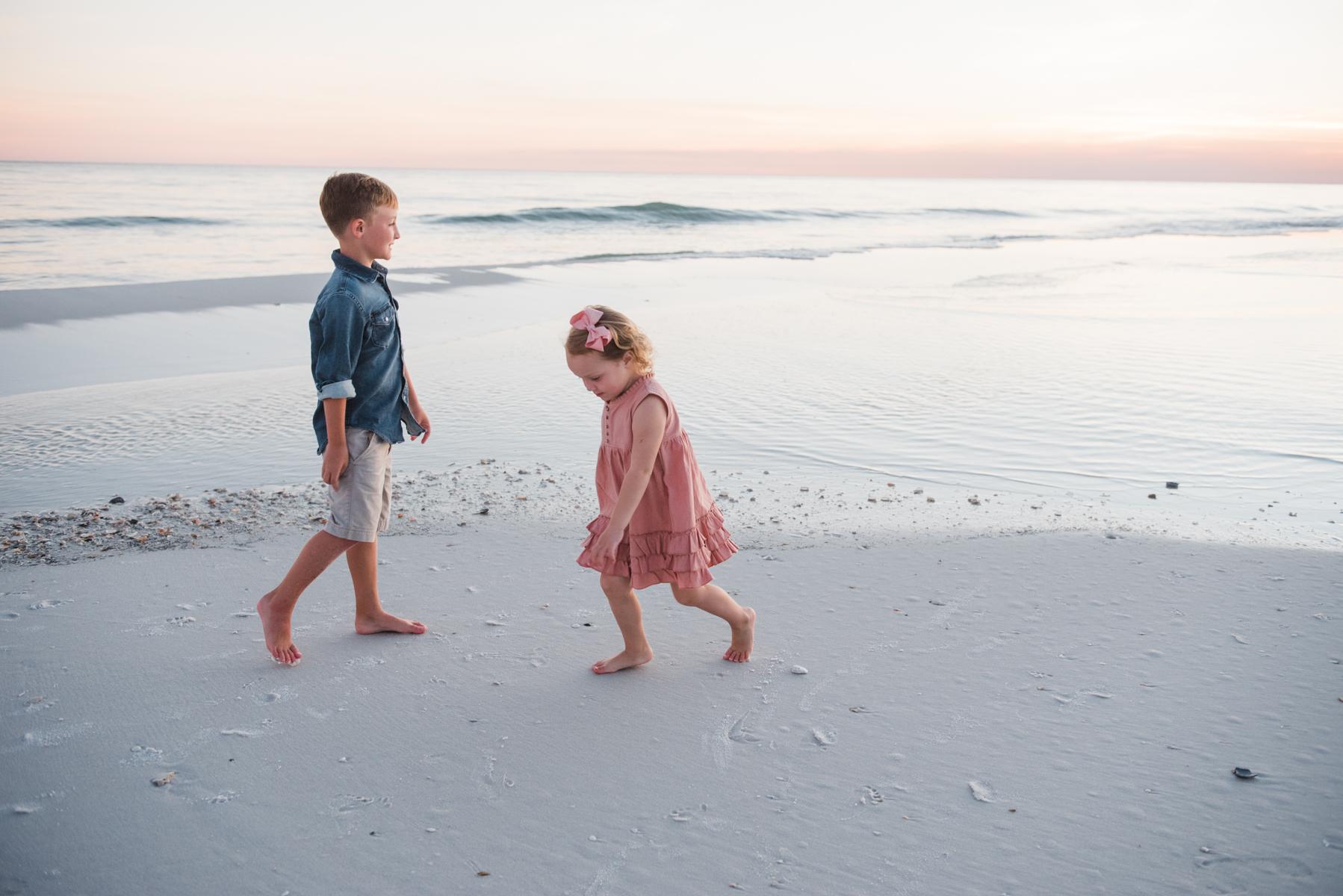 girl and boy at ocean-Pensacola Beach family photographer