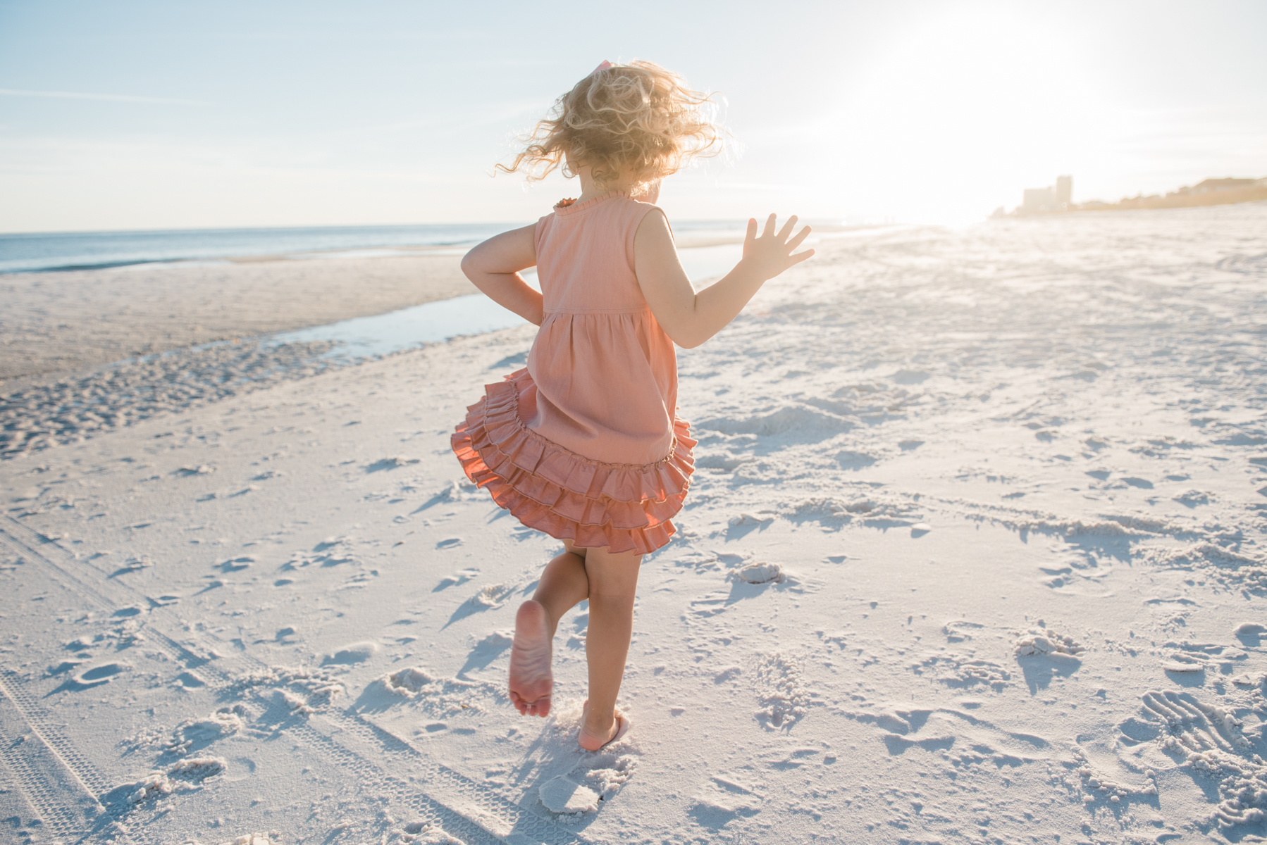 girl twirling at beach-pensacola family photographer