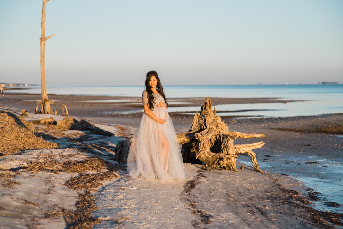 woman at national seashore-pensacola maternity photographer