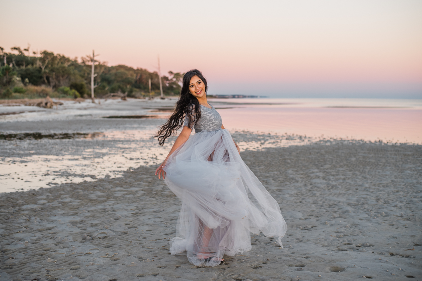 lady twirling by ocean-pensacola maternity photographer