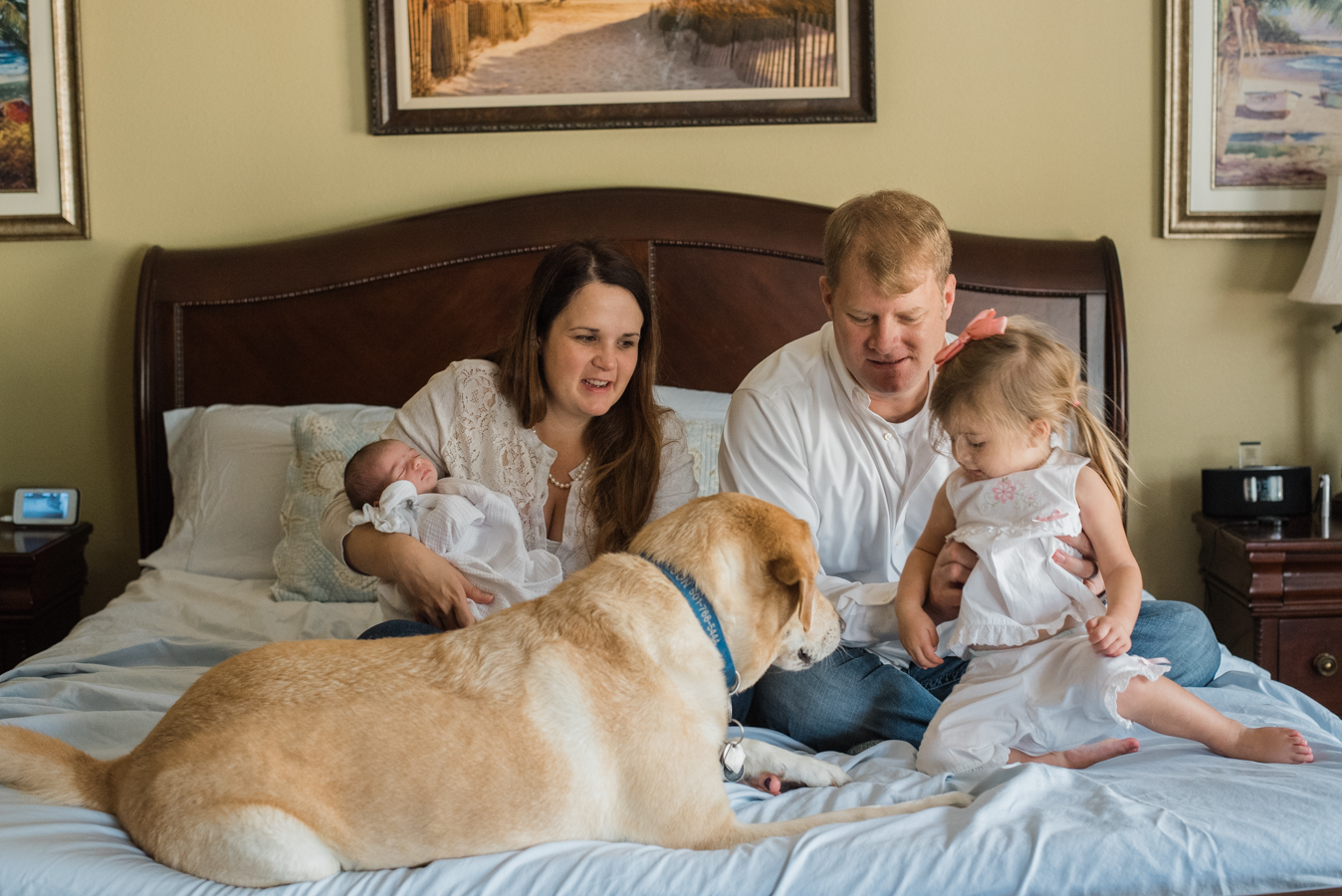 family on bed with dog-Pensacola newborn photographer