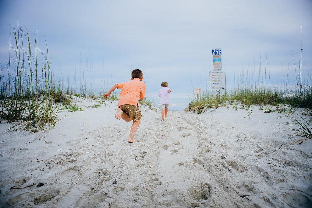 kids running in sand-Pensacola Beach Family Photographer