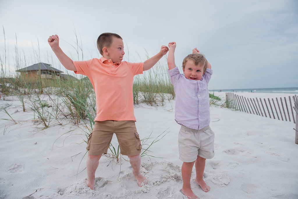 kids jumping in sand-Pensacola Beach Family Photographer