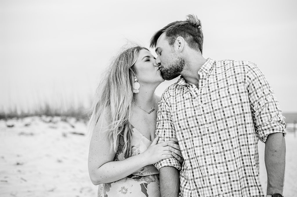 couple kissing at beach-Pensacola Beach Lifestyle Photographer