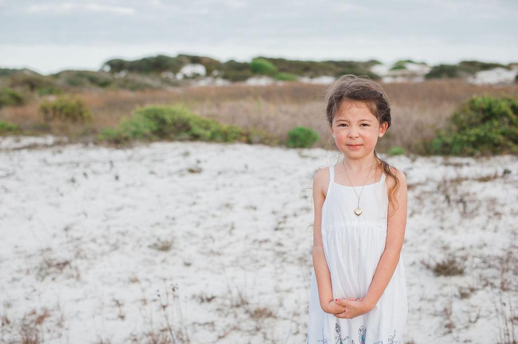 girl standing in dune-pensacola- pensaocola beach family photographer