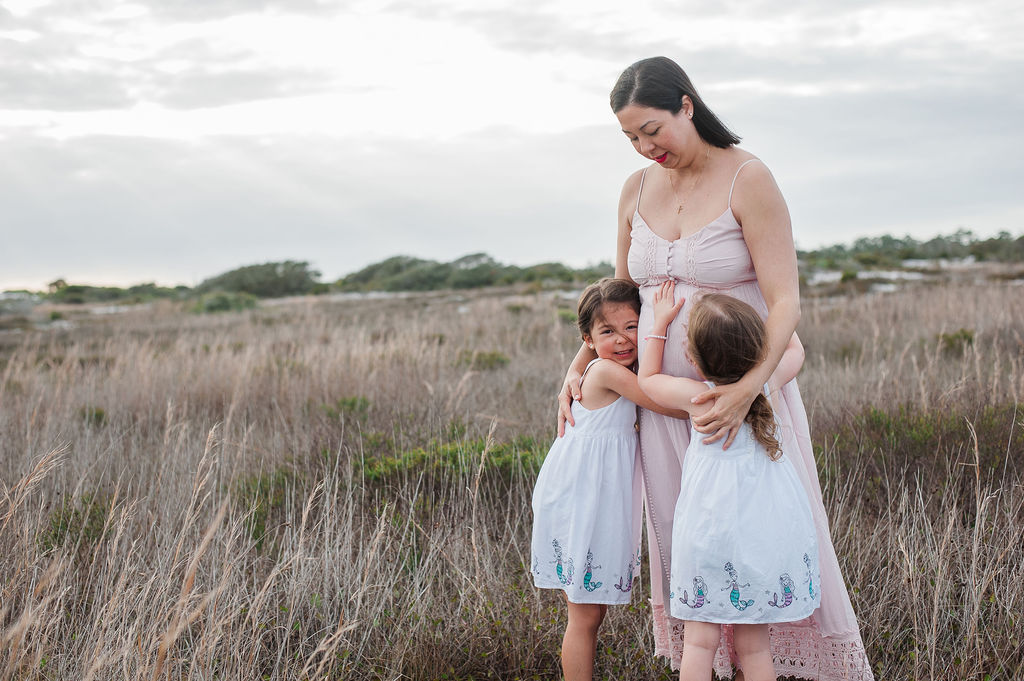 mom hugging girls-Pensacola Beach family photographer