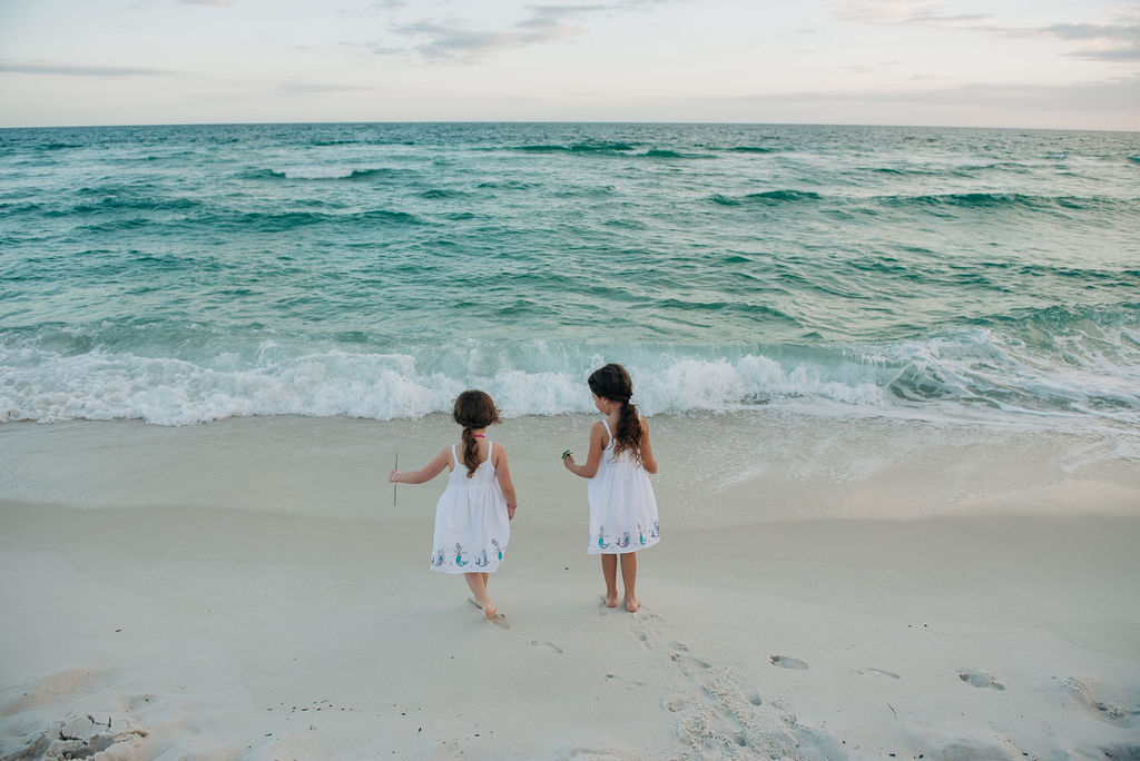 girls by ocean-pensacola beach family photographer