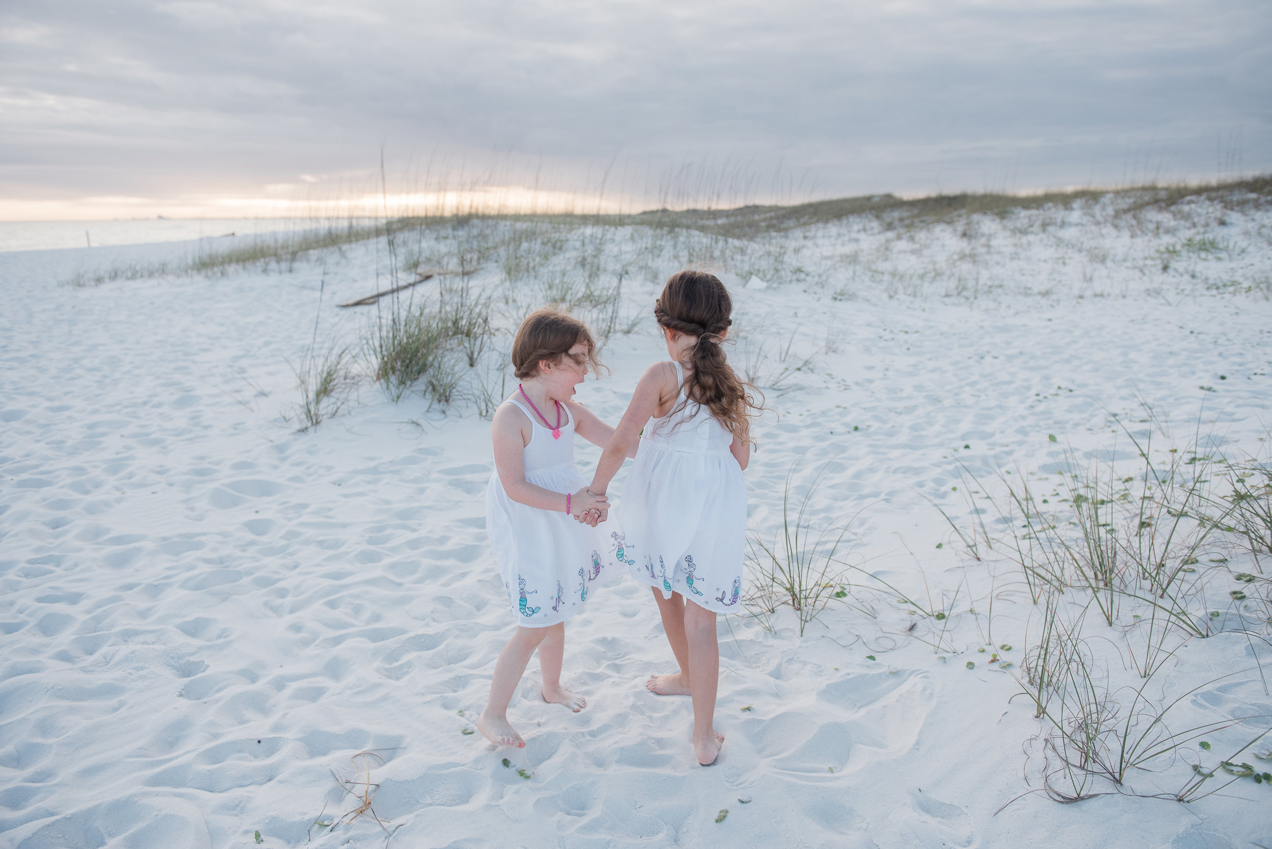 girls twirling- Pensacola beach sessions
