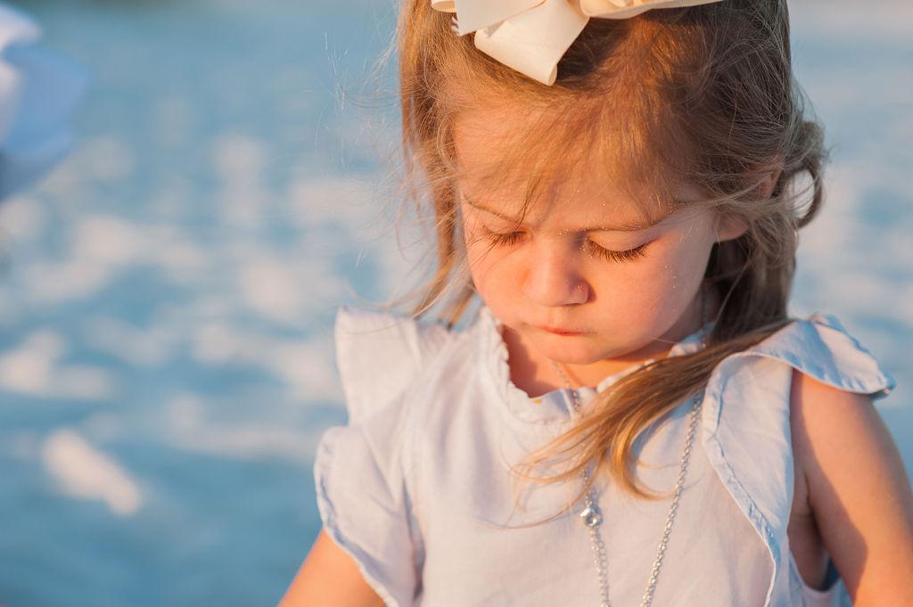 girl in bright light at beach-pensacola beach family photographer