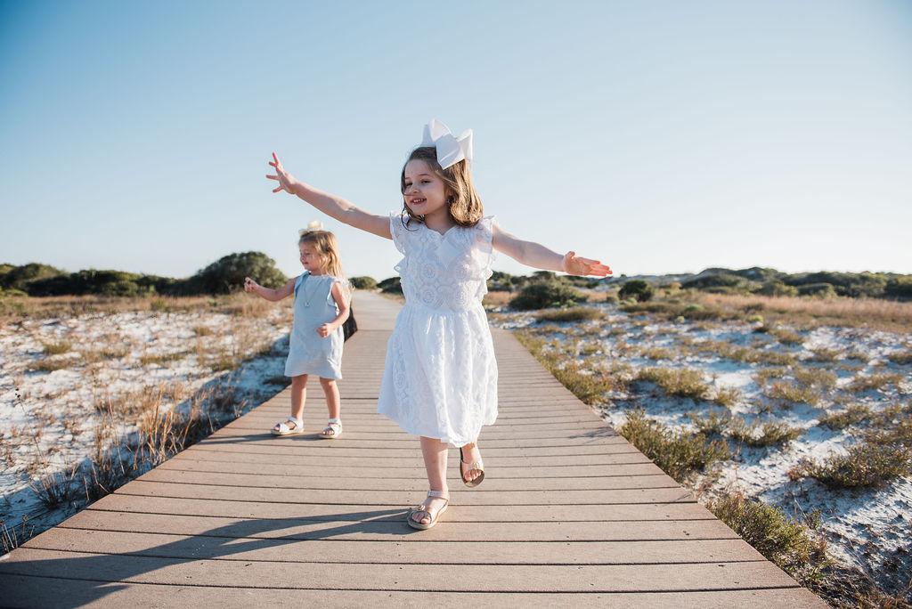girls on boardwalk-pensacola beach family photographer