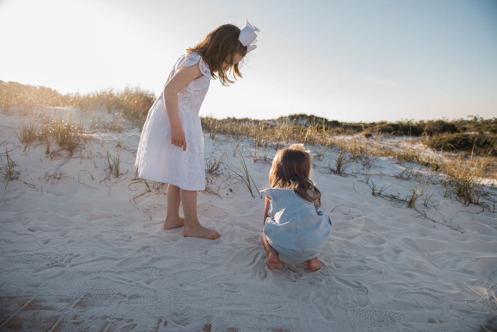 girls playing in sand-pensacola beach family photographer