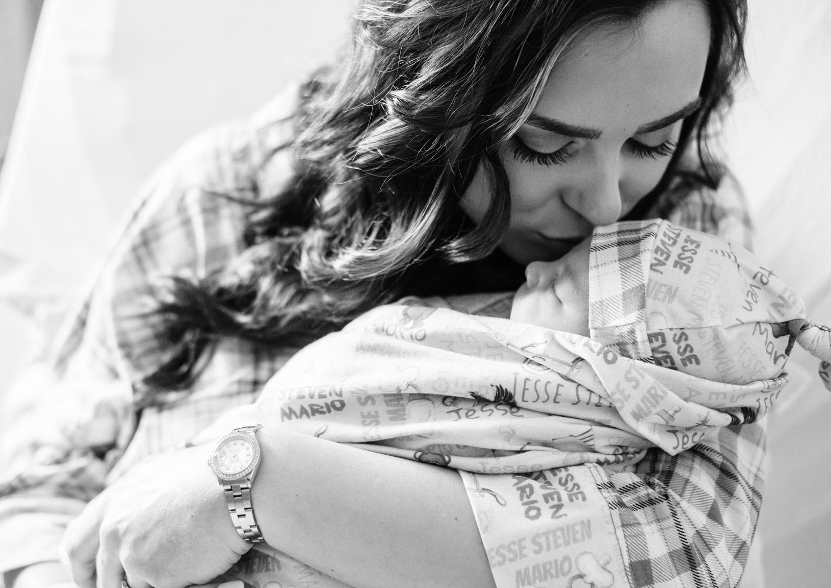 mom kissing baby-pensacola newborn photographer