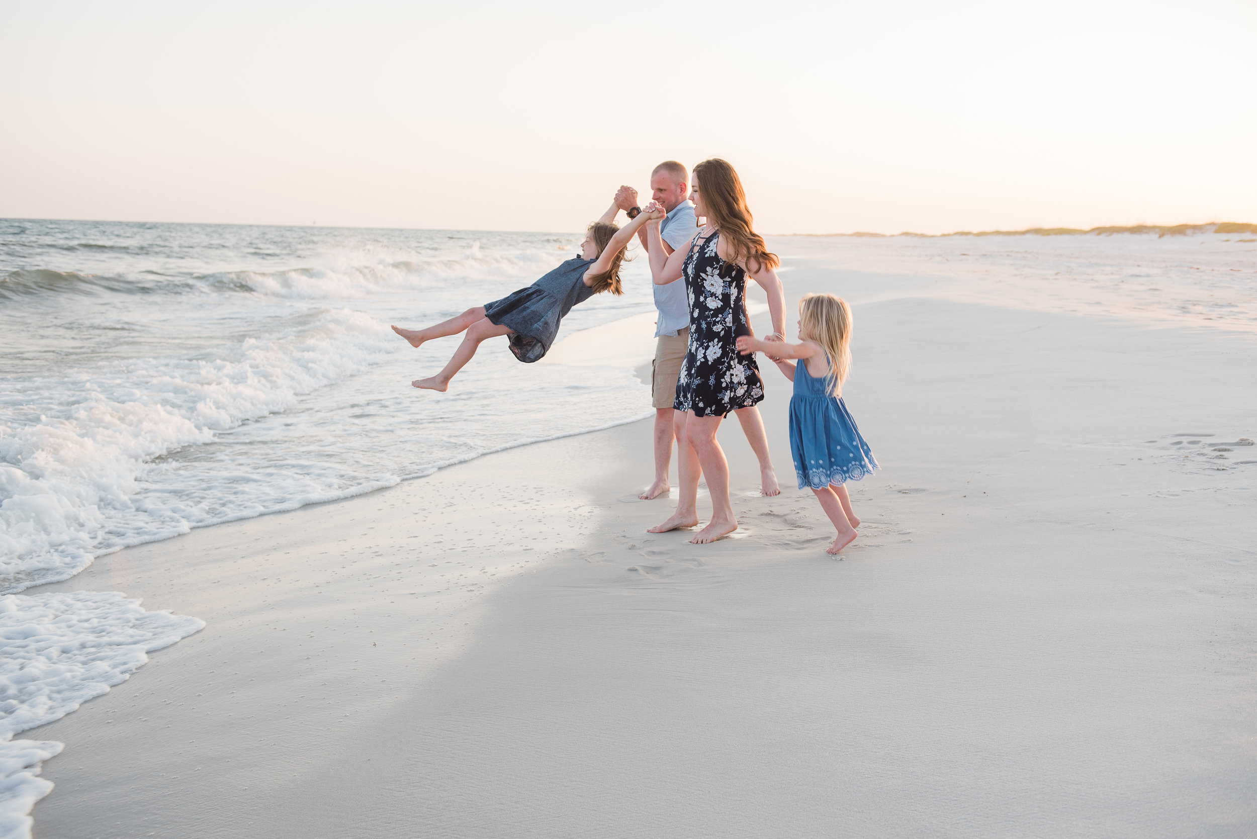 family playing in ocean-pensacola Beach Family photographer