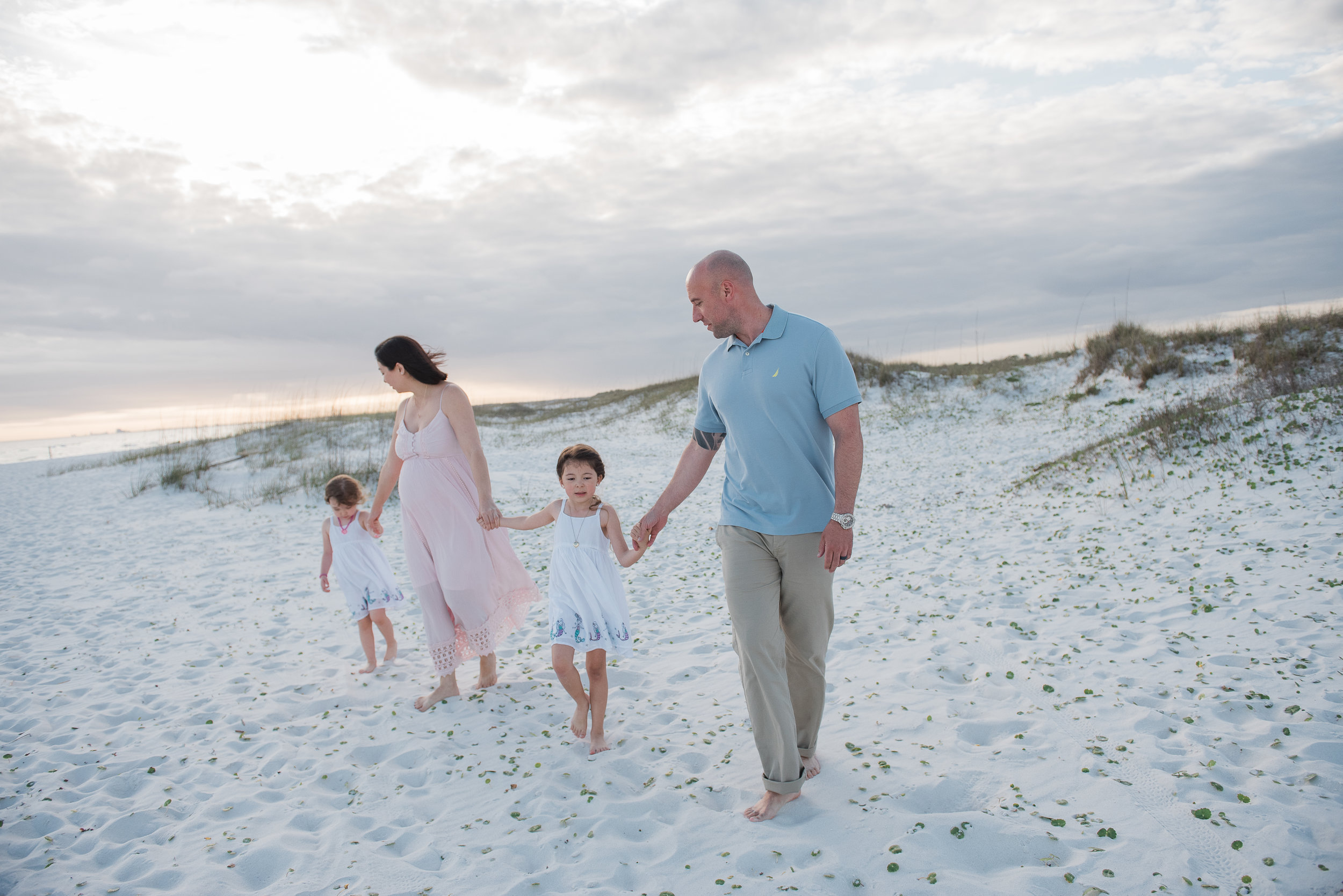 family walking along beach-pensacola family photographer