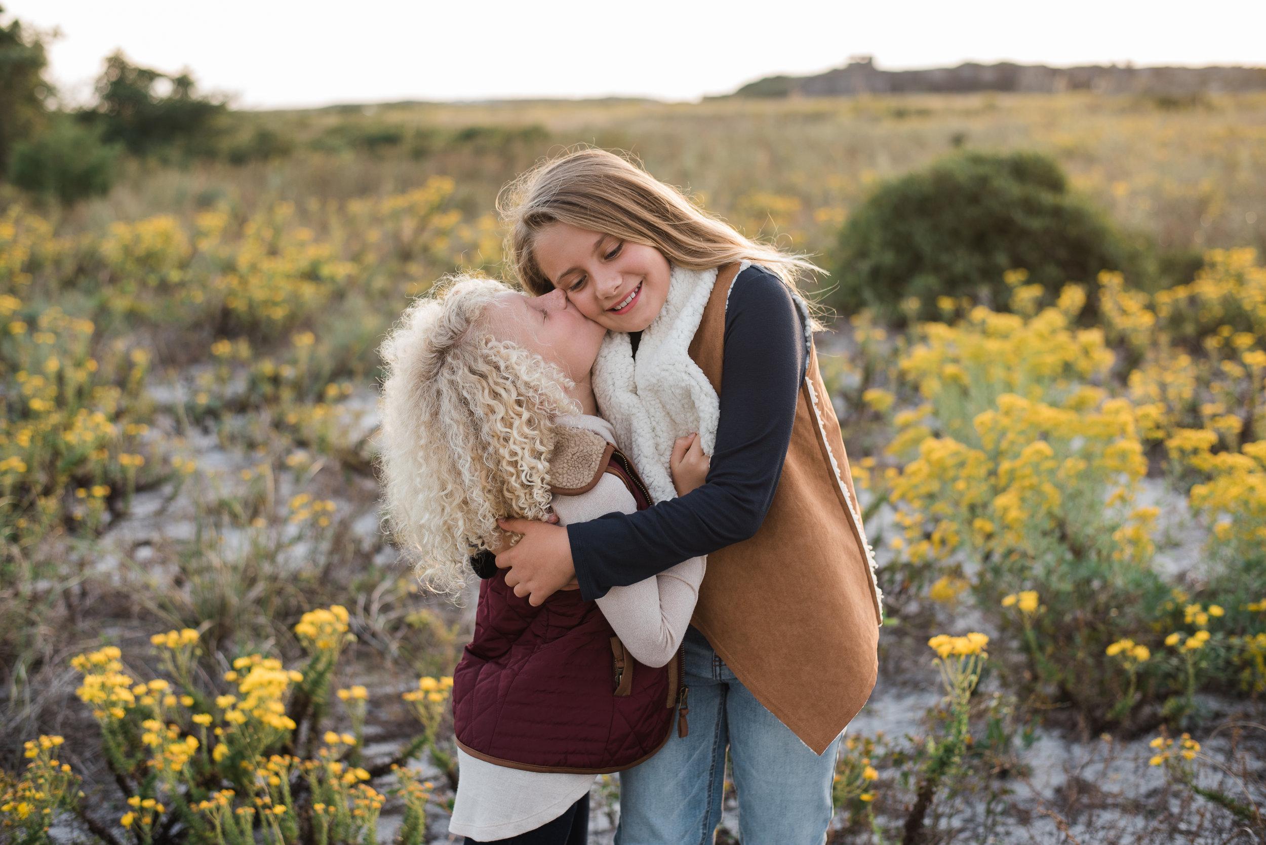 sisters hugging at Fort Pickens- Pensacola Family Photographer