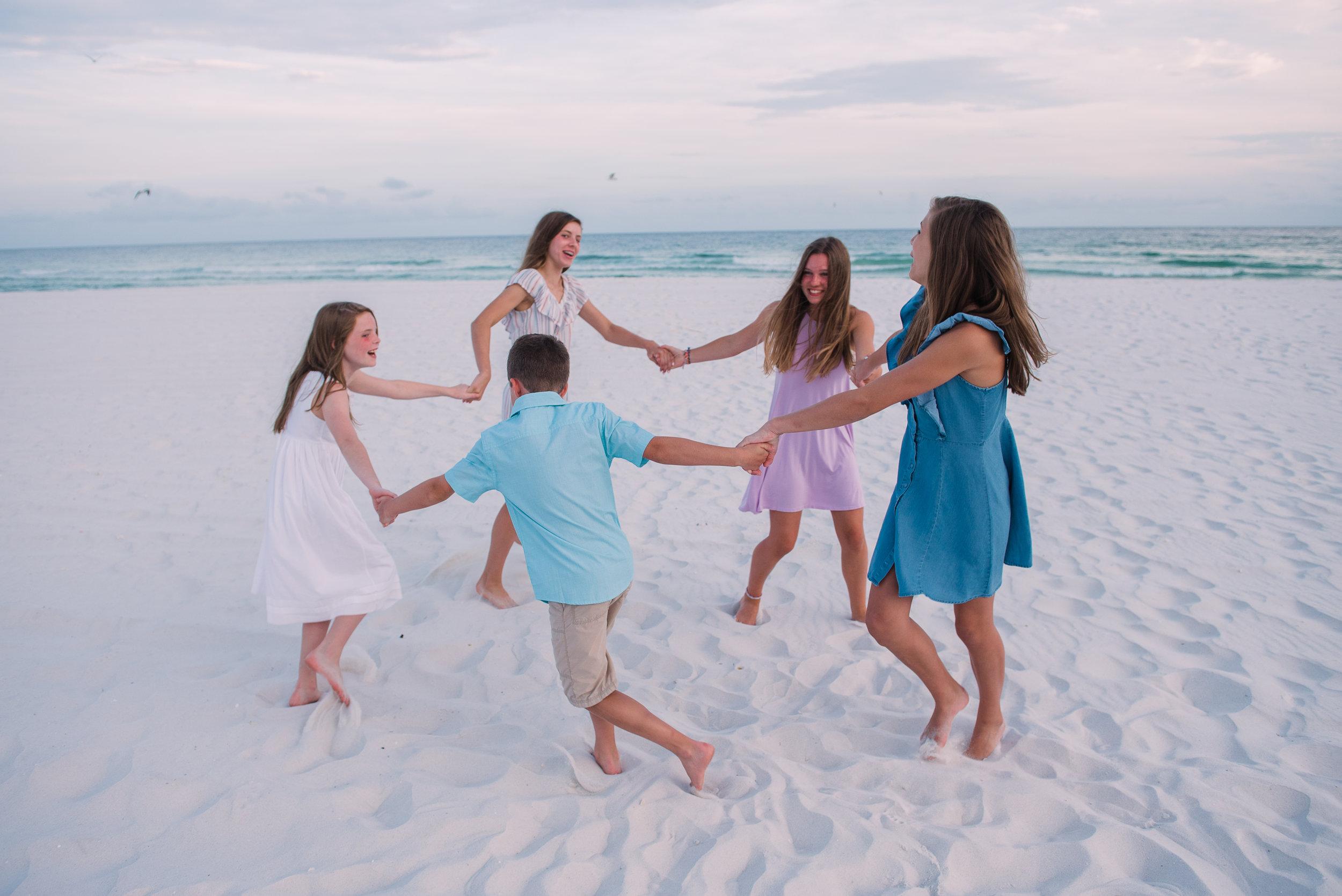 kids in circle at beach- Pensacola family photographer