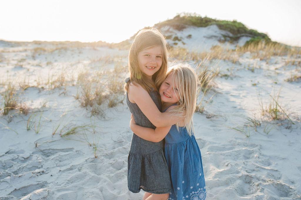 girls hugging at beach-Navarre Beach Photography