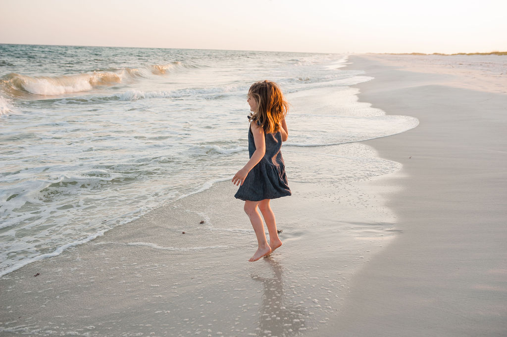 girl jumping waves-Pensacola Beach Photographer